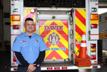 Man Standing in front of Fire Engine