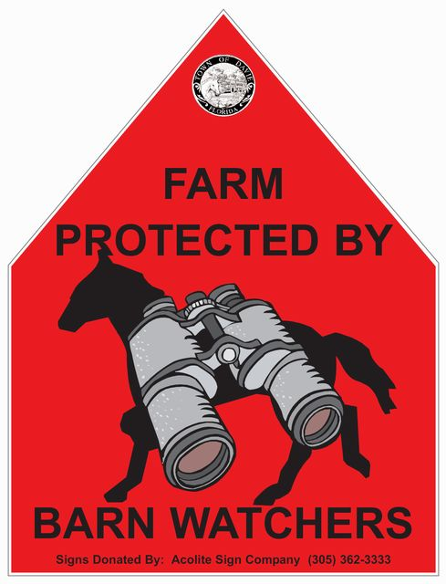 Red hexagonal sign with text: farm protected by Barn Watchers