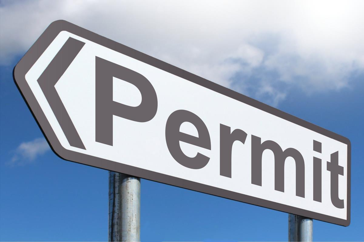 Sign that has the word Permit on it