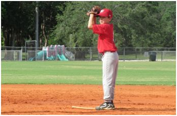 boy at pitchers mound about to pitch