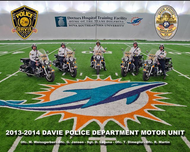 five police officers on motorcycles on the Miami Dolphins field